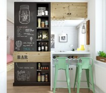 A bar area has been devised as the dividing wall between the lounge and kitchen areas, complete with quirky blackboard feature wall and flip-up bar surface.