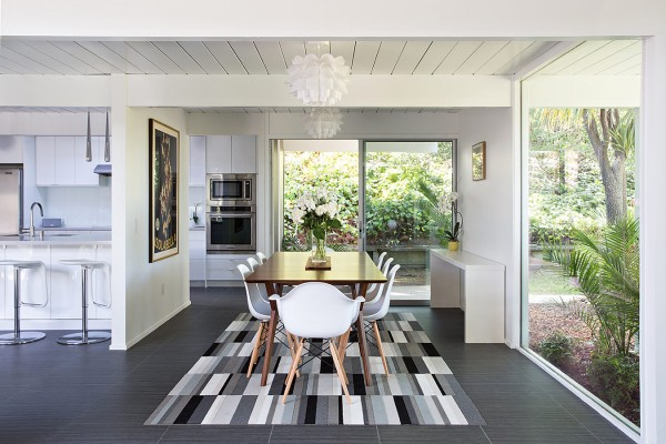 A striking rug acts as a focal point, preventing the white décor scheme from appearing too stark.