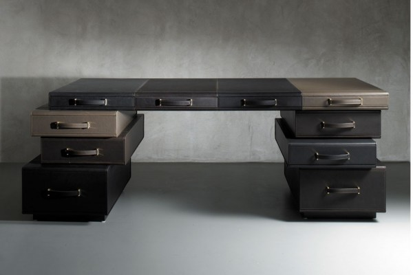 Inspired by the designers love of travel, this Maarten De Ceulaer desk from 'The Leather Collection' is an asymmetric tower of suitcases. The result is a fun yet highly sophisticated piece that would suit all sorts of modern or traditional home office schemes.