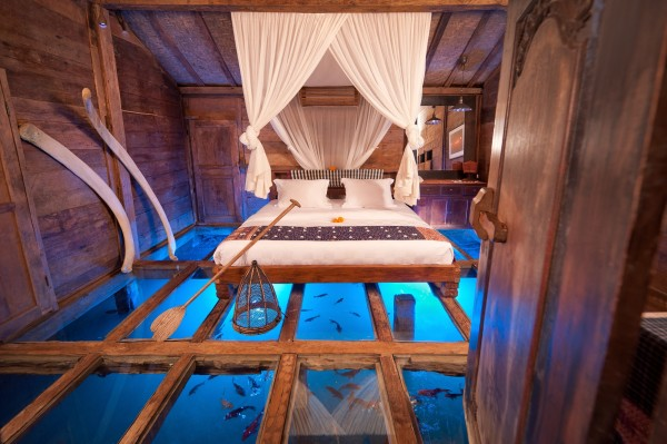 The Udang House, for example, is one of the most unique vacation homes in Bali. Situated above a fresh shrimp pond, this Bambu Indah favorite showcases a tempered glass floor not unlike the one we saw on Patrick Blanc's home office. Relax and watch the shrimp swim in the comfort of your house - a once in a lifetime experience. This bedroom shot intrigued us so much that we ended up looking for the photographer behind it. We were not disappointed. Check out the making of this scene in the video featured at the end of the article.
