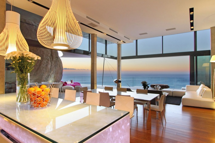Open Concept Dining Kitchen Living Space - Breathtaking villa incorporating boulders in its design