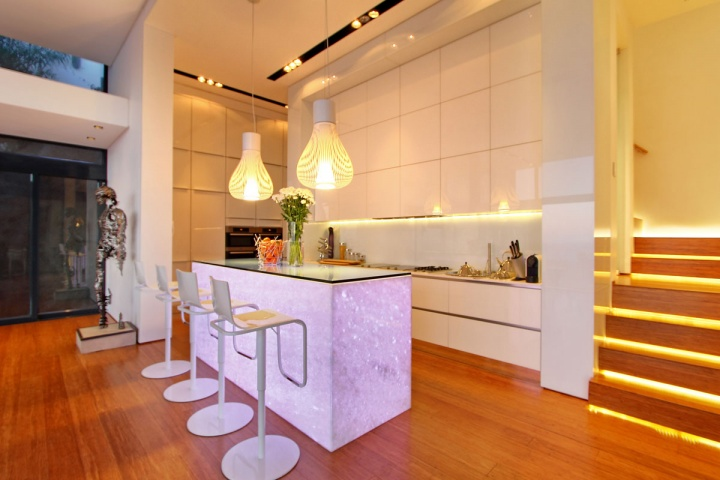 Open White Modern Kitchen - Breathtaking villa incorporating boulders in its design