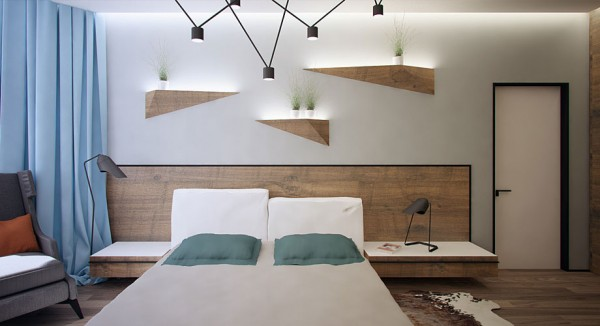 More surprising angles and innovative lighting in the master bedroom with a pulley-style pendant assembly over the bed and faceted shelves that match the flooring and headboard while bathing the plants that they hold in a soft glow from beneath.