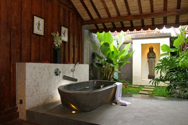Indonesian designer Iwan Sastrawiguna mixes nature as well as spirituality in this bathing area.