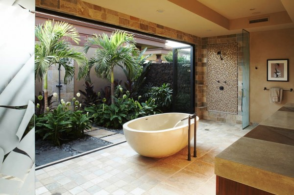 Back to Hawaii, where Willman Interiors provides a sliding glass door/wall to separate two showers - one indoors and one out, so one can always get clean before soaking in privacy while looking out onto a walled courtyard of tropical vegetation, rain or shine.