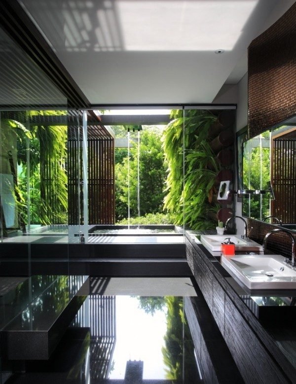 Indonesian photographer Gala Indiga took this shot of a modernist jungle bathroom. Water streaming into the tub from above would make for an excellent massage!