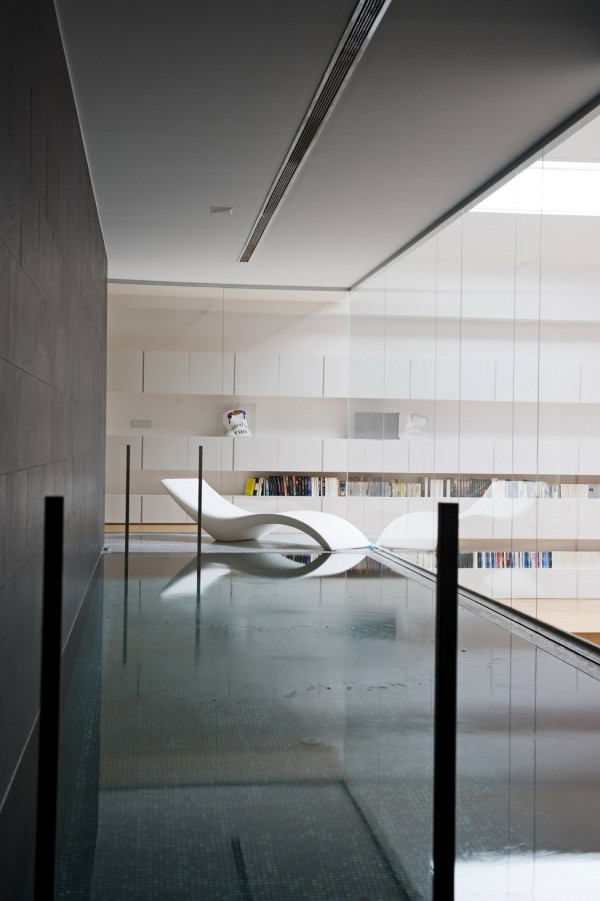 An indoor pool interconnects the gym and bathroom, which in turn leads to the bedroom through the dressing room.