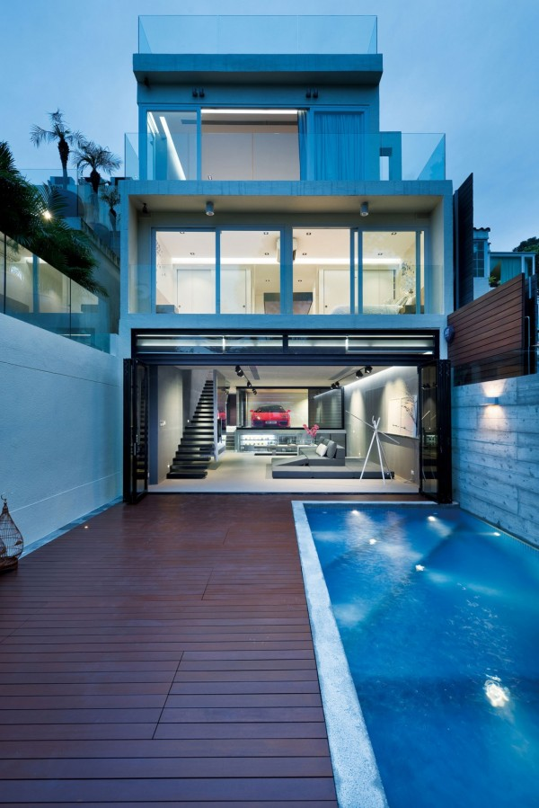 A pool fits snugly into this otherwise narrow backyard, with plenty of deck space for lounging in warm months.