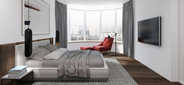 City views are the focus of this bedroom with its awesome window.