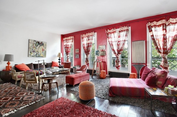 Not every Parisian space will make such dramatic use of red, but it makes this French studio apartment feel like a delicious den of passion.