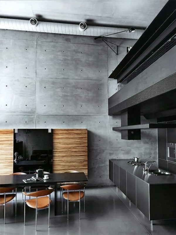 When it comes to modern lofts, using warm wood to offset the cool and sometimes sterile concrete fixtures is essential, as demonstrated here in this modern kitchen.