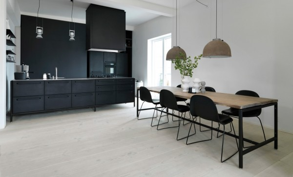 By creating contrast with light flooring and dark cabinetry, this space becomes a bit mysterious and a lot mod.