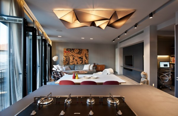 Of particular interest is the overhead lighting which draws the eye with its origami-style angles.