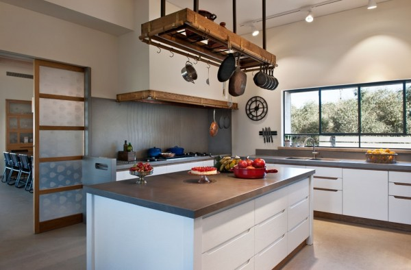 A custom pot rack is always a welcome site and ties together this spacious and beautiful kitchen.