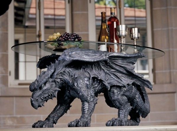 If nature is not quite your thing, bring the supernatural through the door with this coffee table perched on a dragon's back.