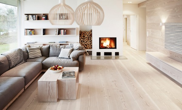 With wood floors, a fireplace, and light fixtures that are reminiscent of bird cages