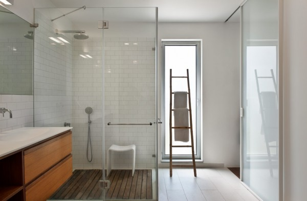 A glass shower with multiple shower heads is the height of indulgent, but practical, luxury.
