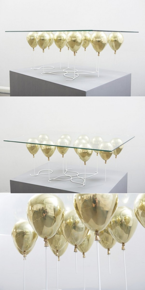 This is a truly designer coffee table. Gold enamel balloons look like they are keeping the clear glass tabletop afloat for a luxurious - and whimsical - effect.