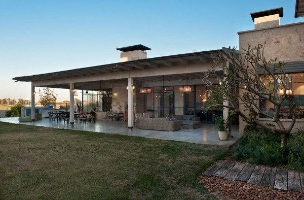 This large stone house has a feel that's a bit reminiscent of a (very stylish) home in the American Southwest.
