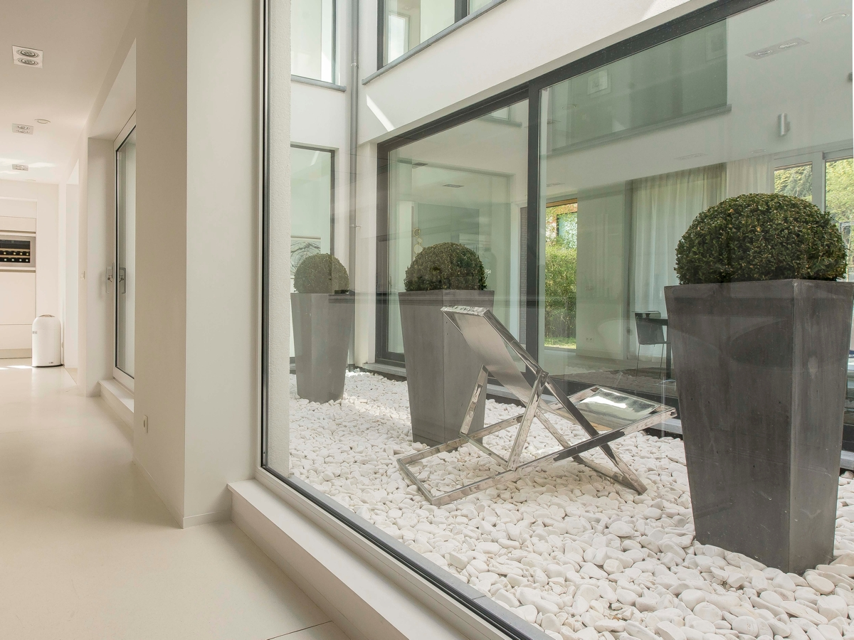 Gravel Patio - Stunning belgian family home with floor to ceiling windows