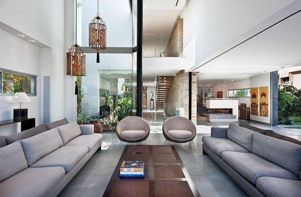 WHile low couches and sleek nest chairs are the ultimate in modern, the dangling light fixtures give the place its own Asian flair.