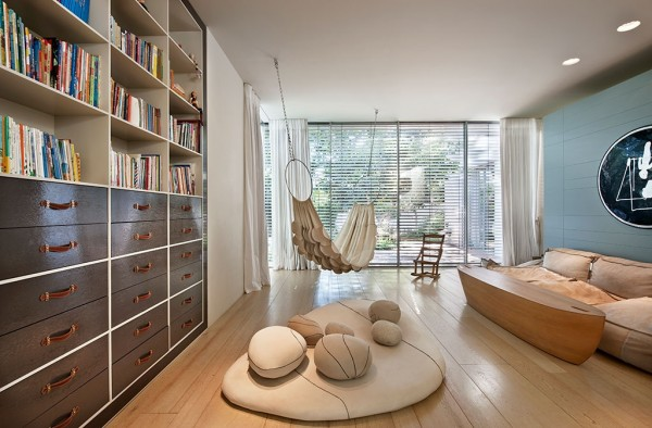 Anyone with a love for literature would swoon over this indoor reading room completely with cushy sofas and indoor hammock.
