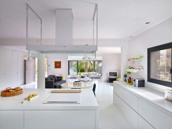 The huge kitchen is sunny and uncluttered, perfect for preparing a meal or just pouring champagne.