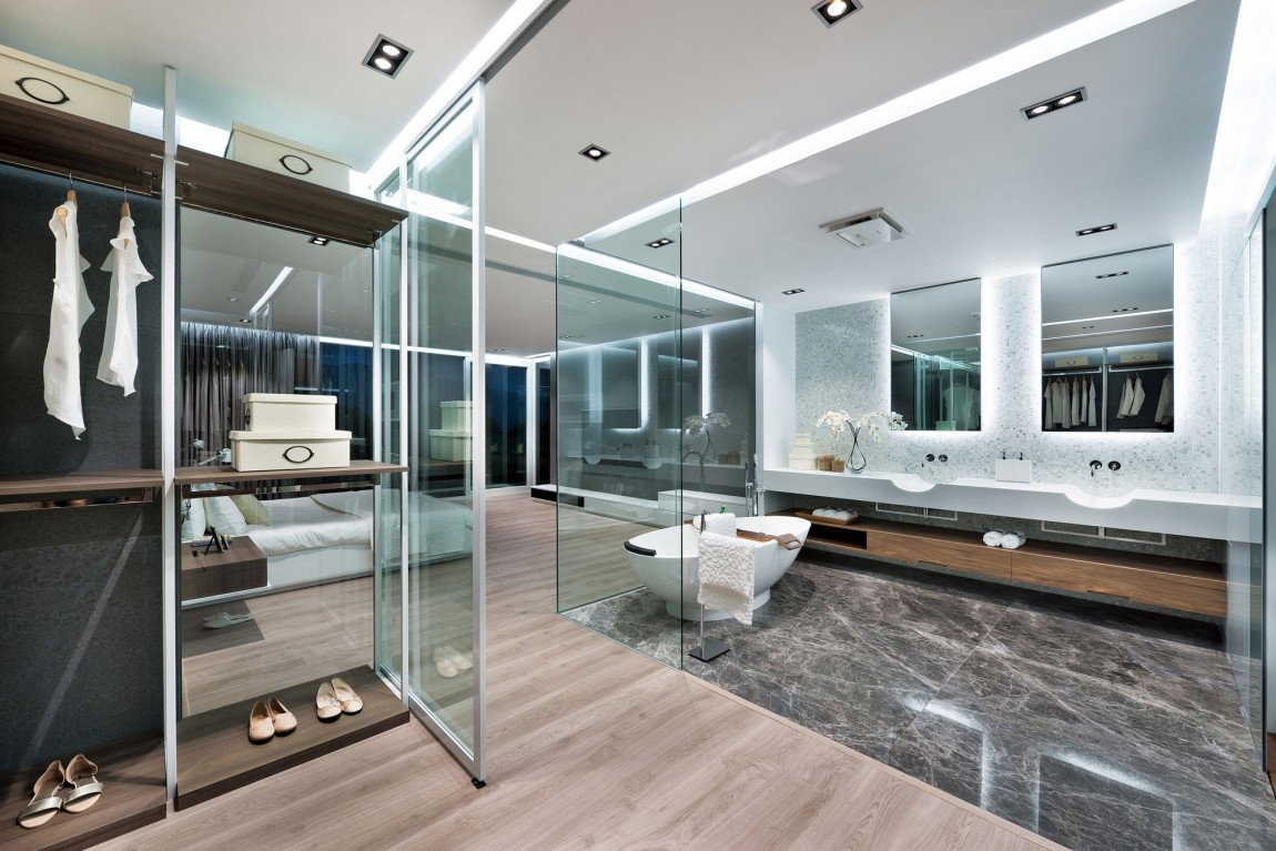 Modern remodel in hong kong with a ferrari as focus for Master suite bathroom