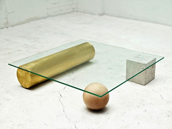 Another table that uses unique shapes as its stabilizing element, this glass topped table is like a piece of practical modern art.