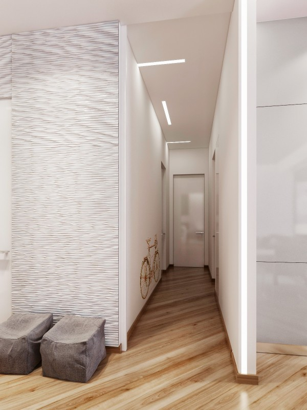 Adding artwork in the form of decals dresses up walls in a narrow hallway without taking up any precious room.