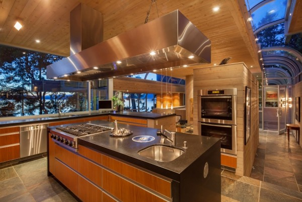 The counters are black honed granite, and the cabinetry panels are of resin-embedded reeds.