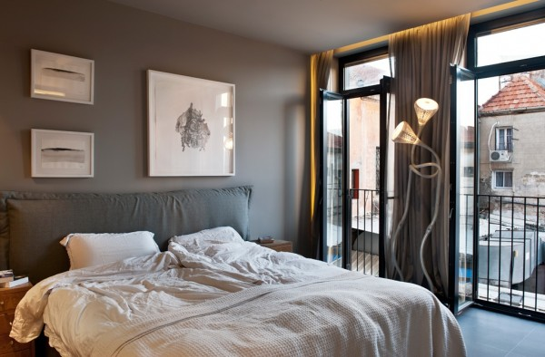 Floor-to-ceiling windows make the apartment bright and airy at any time, even in the bedroom.