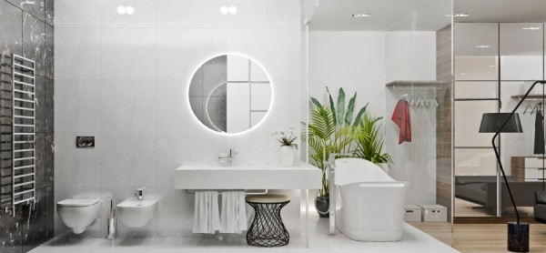A luxury soaking tub and halo lighting around the mirror give the bath an ultramodern feel.