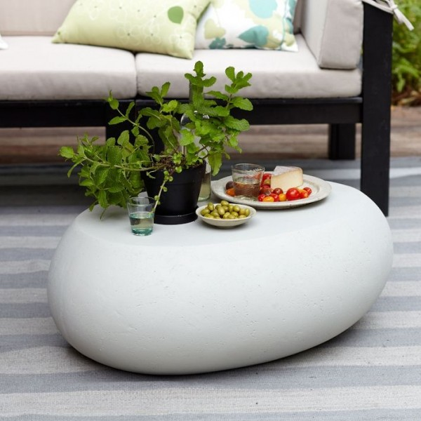 This simple pebble coffee table design from West Elm stands out because its round design means that it could easily double as an ottoman or even a small seat.