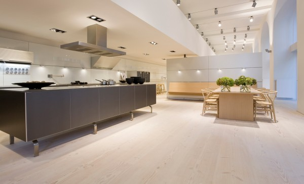 By raising the kitchen island off the floor, the kitchen immediately opens up.