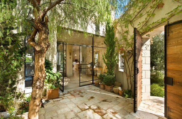 The beautiful entryway is shaded by plenty of greenery, giving it both privacy and vibrance.