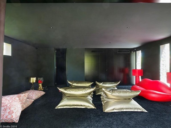 The house even has a private screening room, complete with floor seating that looks like it came straight from Studio 54.