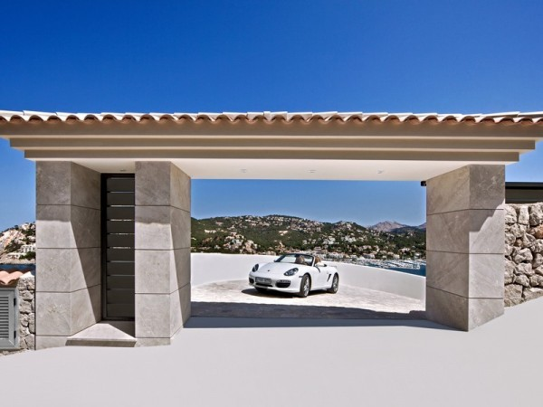 A private driveway, complete with its own entryway arch, makes every visit feel like a real entrance.