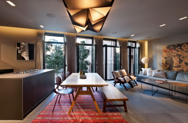 Even without much space, the furniture and flooring creates distinct areas, making the room seem much bigger.