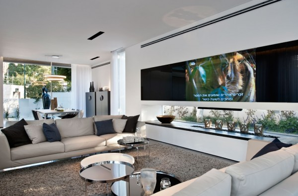 It is always lovely when designers find a good way to include a television without giving it center stage in the design.