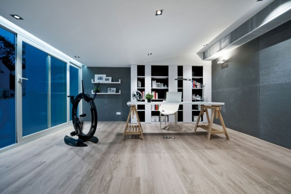 A well appointed home office is a modern home requirement. This open plan gives plenty of space to keep ideas moving and even includes a highly coveted carbon fiber exercise bike for multitasking.