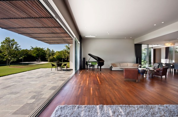 Dark wood floors contrast with soft plush rugs and sofas.