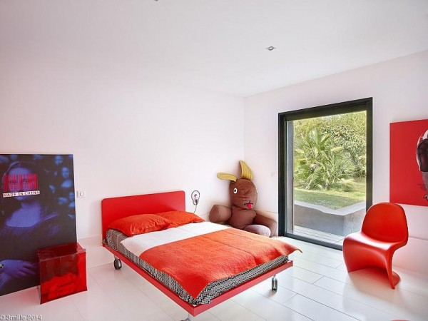 There's no telling if this stylish room is intended for a child or just an adult who never really felt like growing up.