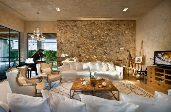 Classically styled chairs coupled with simple white sofas make this living area entirely practical but still stylish.