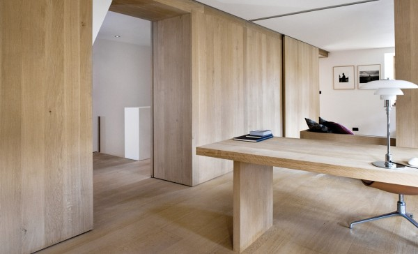 By creating walls and even a desk that match the wood flooring, inhabitants of this home might feel like they live inside a tree.