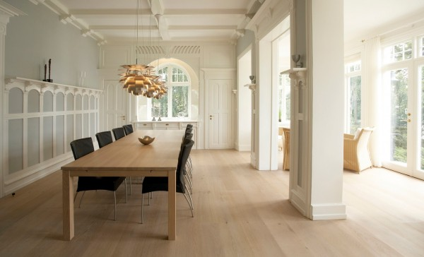 The funky light fixtures give this formal dining room a little whimsy.