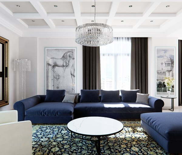 The designer also offers another version of the living room area that has its own classic style, starting with old world art and royal blue sofas.