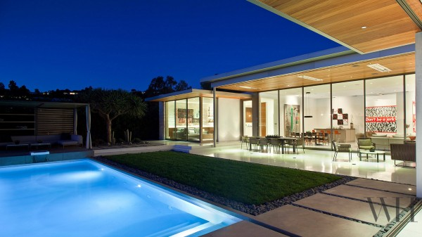 The open house with its low, modern design takes full advantage of the views, making walls out of windows.