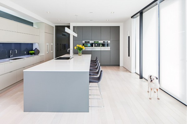 The kitchen, with a long breakfast bar, is entirely welcoming for guests.