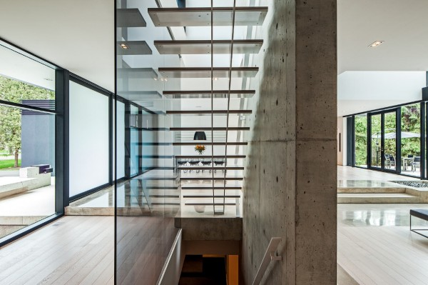 A central concrete bearing wall is casually unfinished, but the effect is striking.